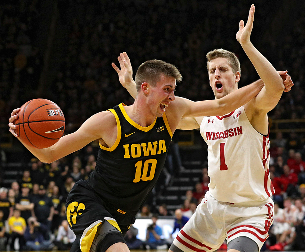Iowa Hawkeyes guard Joe Wieskamp (10) drives in on Wisconsin Badgers guard Brevin Pritzl (1) with the ball during the second half of their game at Carver-Hawkeye Arena in Iowa City on Monday, January 27, 2020. (Stephen Mally/hawkeyesports.com)