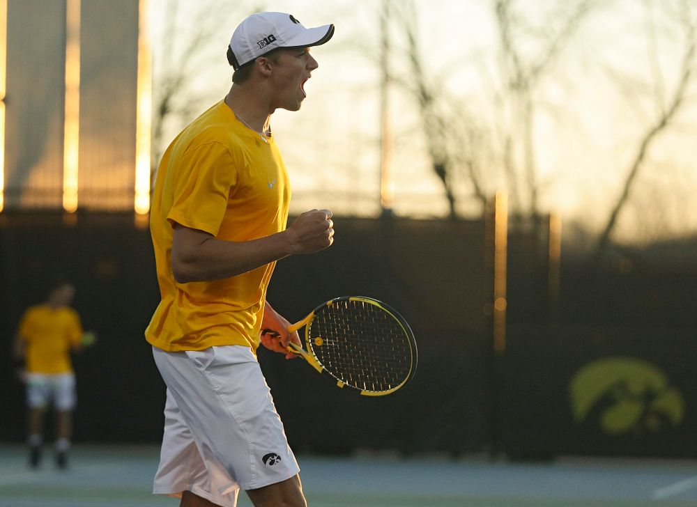 Iowa's Joe Tyler celebrates after winning his match again Michigan State at the Hawkeye Tennis and Recreation Complex in Iowa City on Friday, Apr. 19, 2019. (Stephen Mally/hawkeyesports.com)