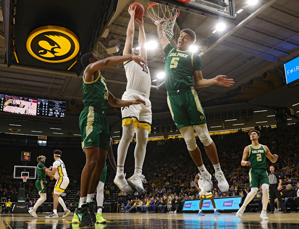 Iowa Hawkeyes forward Ryan Kriener (15) dunks the ball during the first half of their game at Carver-Hawkeye Arena in Iowa City on Sunday, Nov 24, 2019. (Stephen Mally/hawkeyesports.com)