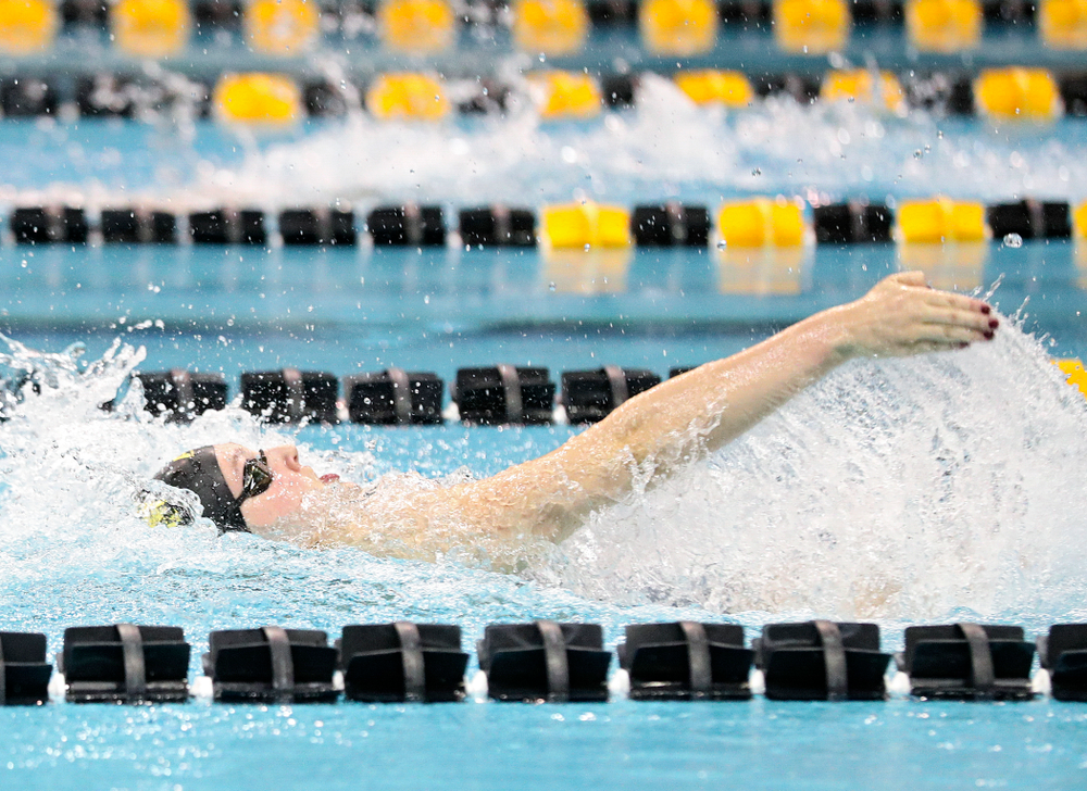 Iowa's Millie Sansome swims the backstroke section in the women's 400 yard medley relay event during their meet at the Campus Recreation and Wellness Center in Iowa City on Friday, February 7, 2020. (Stephen Mally/hawkeyesports.com)