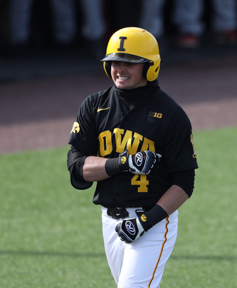 Iowa Hawkeyes infielder Mitchell Boe (4) reacts after hitting a game tying three-run homer against California State Northridge Sunday, March 17, 2019 at Duane Banks Field. (Brian Ray/hawkeyesports.com)