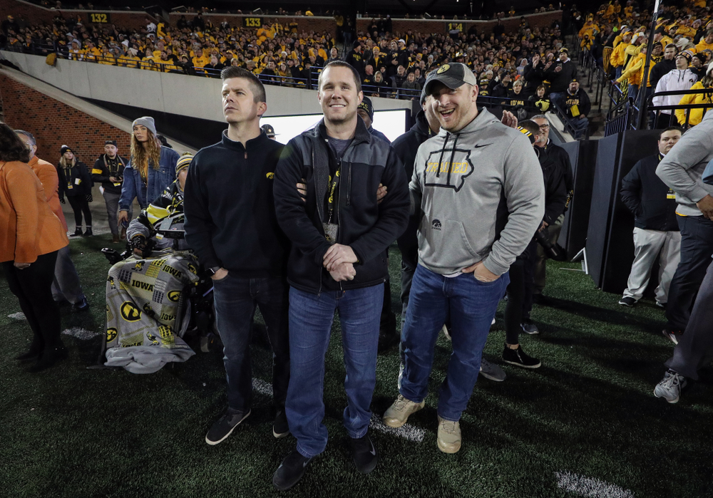 Former Hawkeyes Joe Conklin, Brett Greenwood, and Pat Angerer are recognized with the rest of the 2009 team during the Iowa Hawkeyes game against the Penn State Nittany Lions Saturday, October 12, 2019 at Kinnick Stadium. (Brian Ray/hawkeyesports.com)
