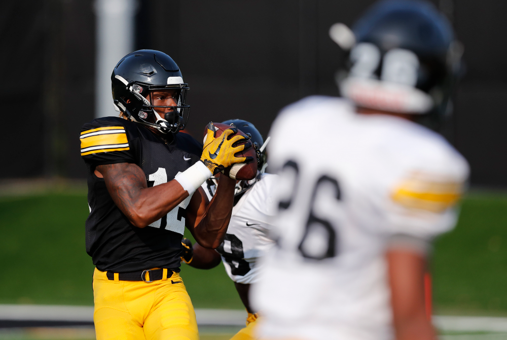 Iowa Hawkeyes wide receiver Brandon Smith (12) during camp practice No. 16 Tuesday, August 21, 2018 at the Hansen Football Performance Center. (Brian Ray/hawkeyesports.com)