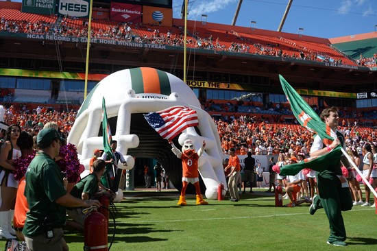 Sebastian the Ibis leads the University of Miami Hurricanes through a tunnel of smoke in a game against the Georgia Tech Yellow Jackets at Sun Life...