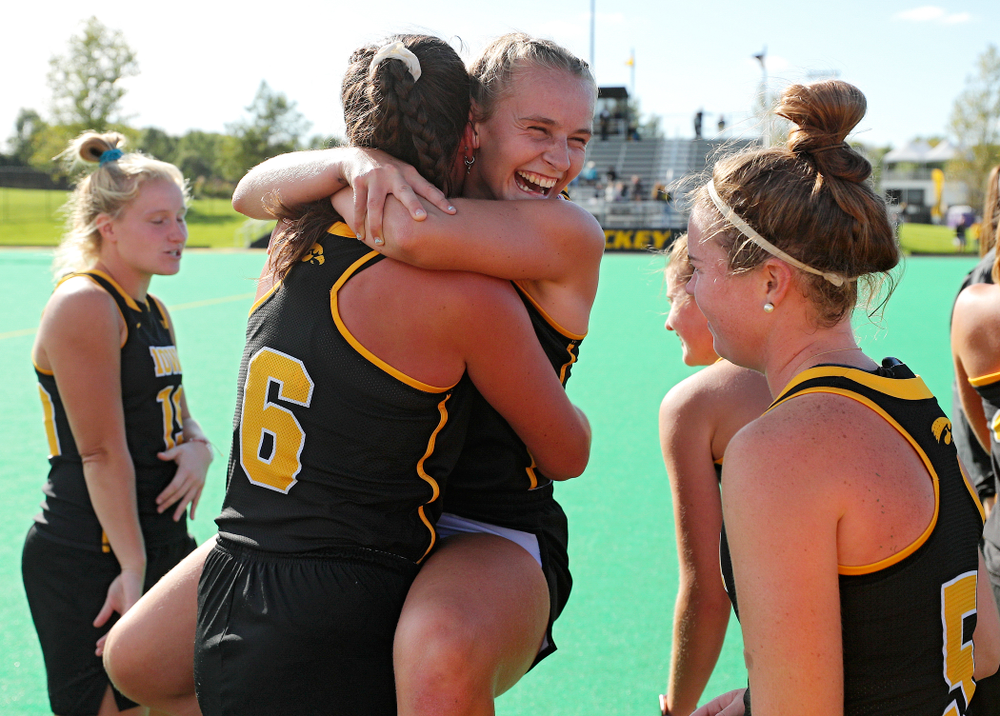 Iowa's Katie Birch (11) jumps into the arms of Anthe Nijziel (6) after defeating Rutgers in their match at Grant Field in Iowa City on Friday, Oct 4, 2019. (Stephen Mally/hawkeyesports.com)