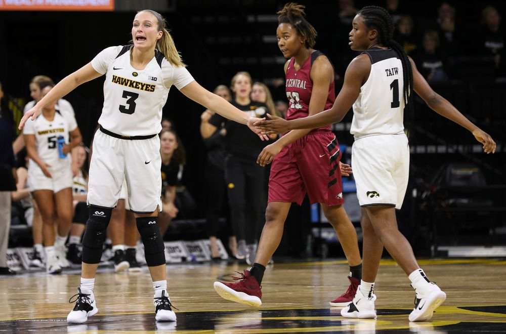 Iowa Hawkeyes guard Makenzie Meyer (3) high fives Iowa Hawkeyes guard Tomi Taiwo (1) after a made basket during a game against North Carolina Central at Carver-Hawkeye Arena on November 17, 2018. (Tork Mason/hawkeyesports.com)