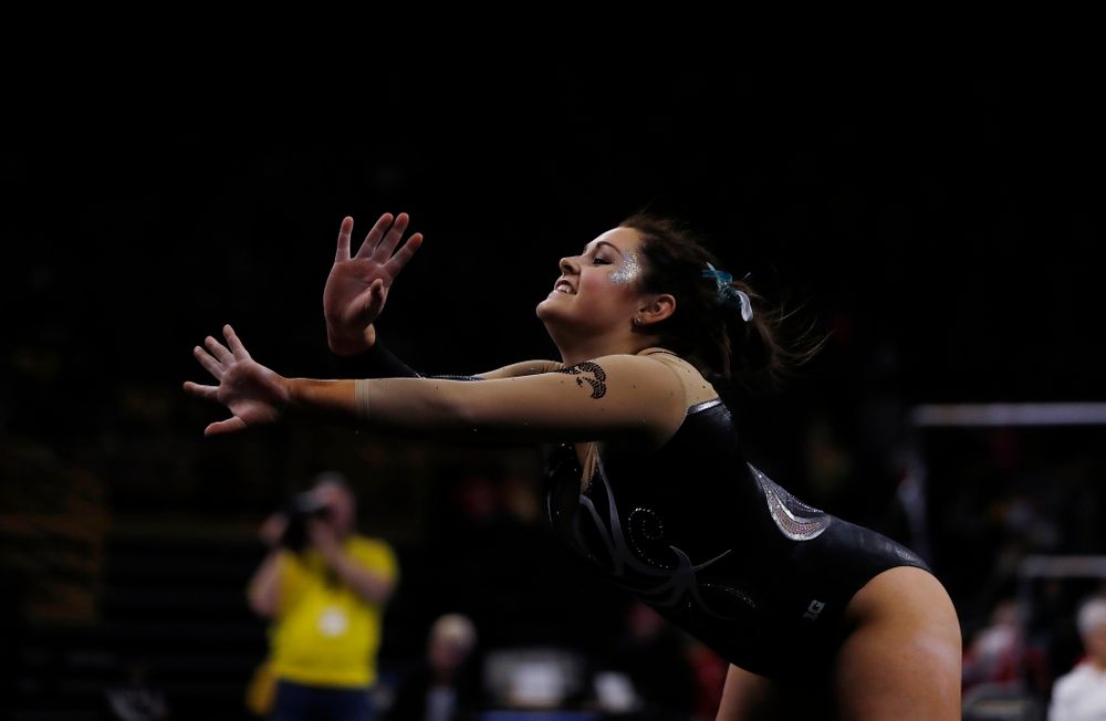 Iowa's Erin Castle competes on the floor against the Nebraska Cornhuskers