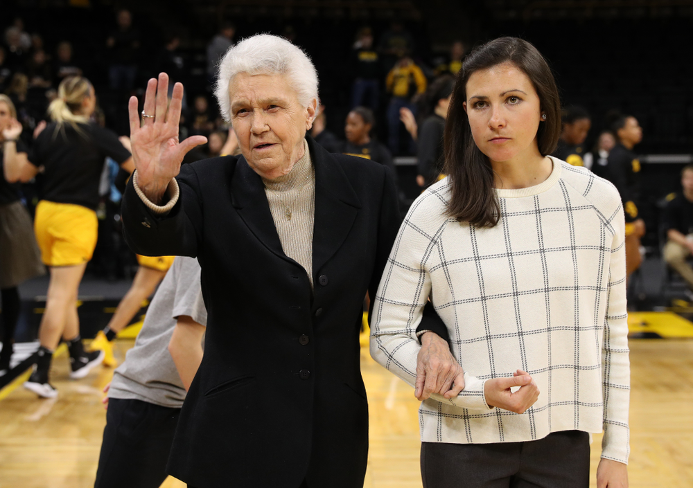 Former University of Iowa Director of Intercollegiate Athletics for Women Dr. Christine Grant receives her trophy for being inducted into the WomenÕs Basketball Hall of Fame from Iowa Hawkeyes head coach Lisa Bluder and director of basketball operations Kathryn Reynolds 