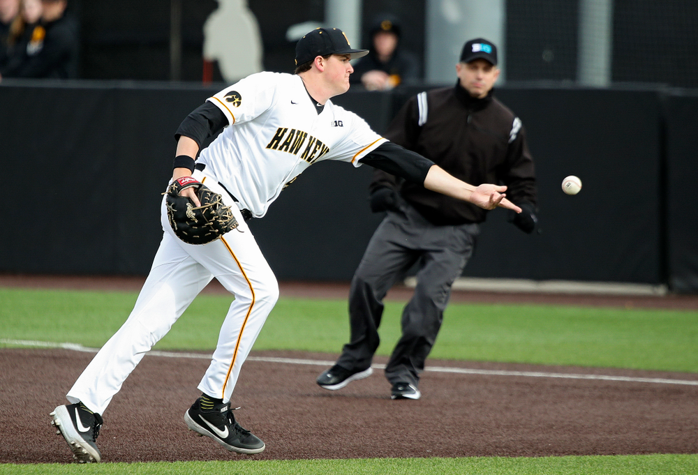 Iowa first baseman Peyton Williams (45) tosses a ball to first for an out during the seventh inning of their college baseball game at Duane Banks Field in Iowa City on Wednesday, March 11, 2020. (Stephen Mally/hawkeyesports.com)