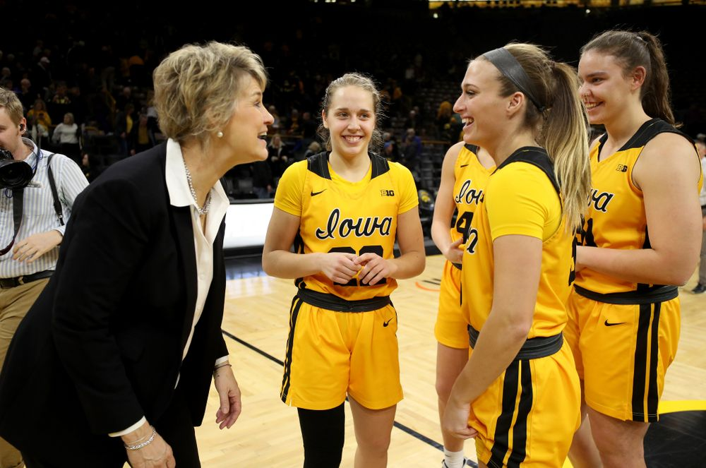 Iowa Hawkeyes head coach Lisa Bluder laughs with seniors Kathleen Doyle, Makenzie Meyer, Amanda Ollinger, and Paula Valiño Ramos during senior day activities following their win over the Minnesota Golden Gophers Thursday, February 27, 2020 at Carver-Hawkeye Arena. (Brian Ray/hawkeyesports.com)