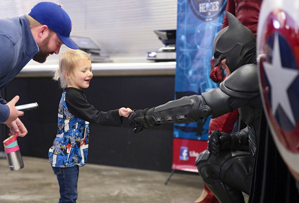 A young fan gets a fist bump from Batman on Superhero and Princess Day before the meet at Carver-Hawkeye Arena in Iowa City on Sunday, March 8, 2020. (Stephen Mally/hawkeyesports.com)
