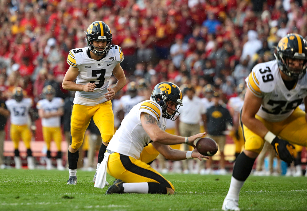 Iowa Hawkeyes place kicker Keith Duncan (3) lines up to kick a field goal as punter Colten Rastetter (7) handles the snap during the first quarter of their Iowa Corn Cy-Hawk Series game at Jack Trice Stadium in Ames on Saturday, Sep 14, 2019. (Stephen Mally/hawkeyesports.com)