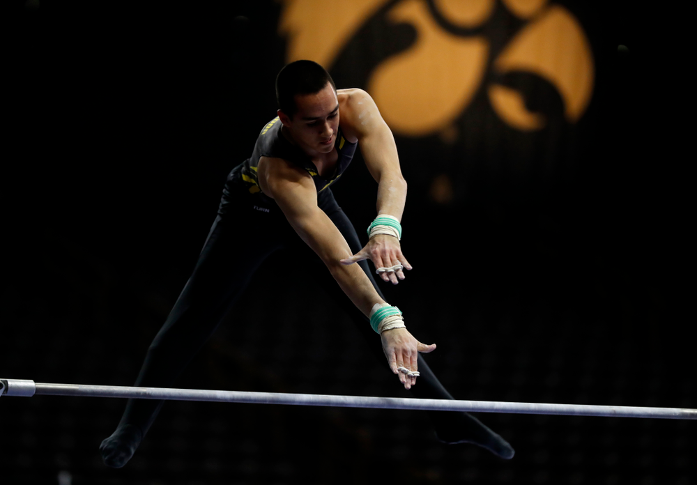 Andrew Herrador competes on the high bar against Minnesota and Air Force