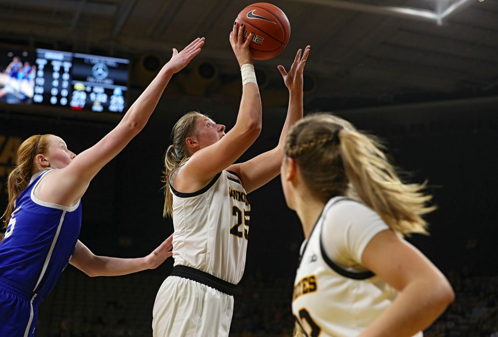 Iowa Hawkeyes forward Monika Czinano (25) scores a basket after taking a pass from guard Kathleen Doyle (22) during the second quarter of their game at Carver-Hawkeye Arena in Iowa City on Saturday, December 21, 2019. (Stephen Mally/hawkeyesports.com)