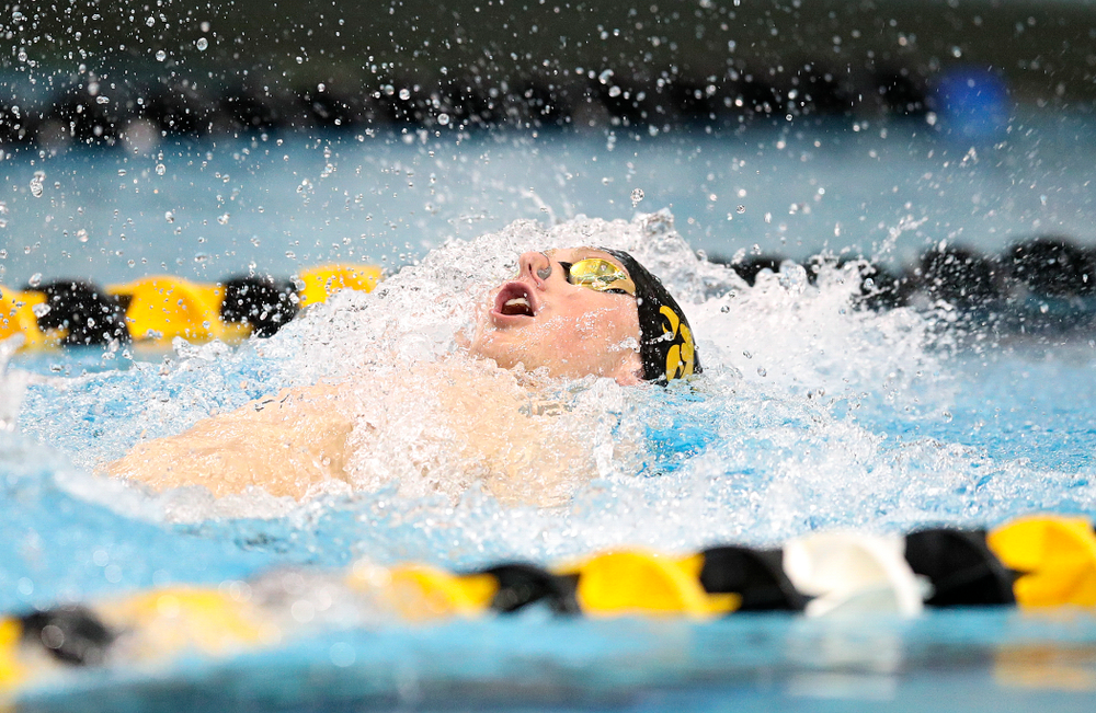 Iowa's John Colin swims the backstroke section in the men's 400 yard medley relay event during their meet at the Campus Recreation and Wellness Center in Iowa City on Friday, February 7, 2020. (Stephen Mally/hawkeyesports.com)