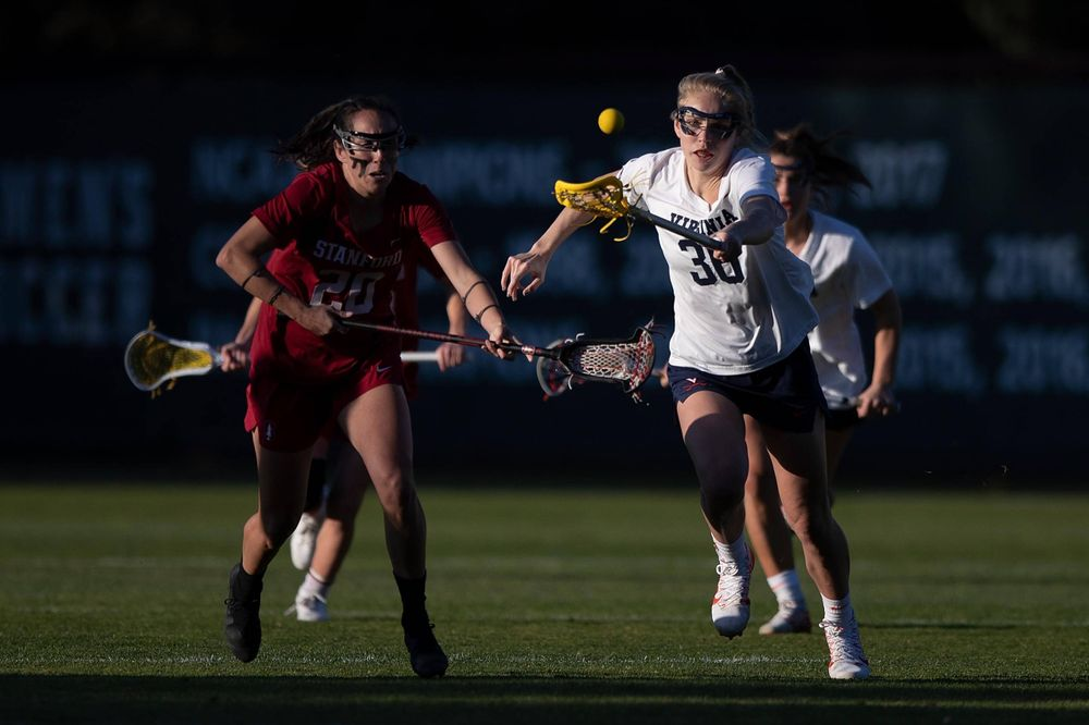 STANFORD, California - FEBRUARY 14:  Virginia Cavaliers midfield Anna Hauser (36) reaches for the ball after a draw with Stanford Cardinal midfield Genesis Lucero (20) during the second half at Cagan Stadium on February 14, 2020 in Stanford, California. The Virginia Cavaliers defeated the Stanford Cardinal 12-11. (Photo by Jason O. Watson)
