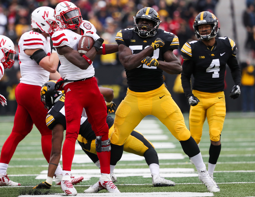 Iowa Hawkeyes linebacker Amani Jones (52) reacts after making a tackle on a kickoff during a game against Nebraska at Kinnick Stadium on November 23, 2018. (Tork Mason/hawkeyesports.com)