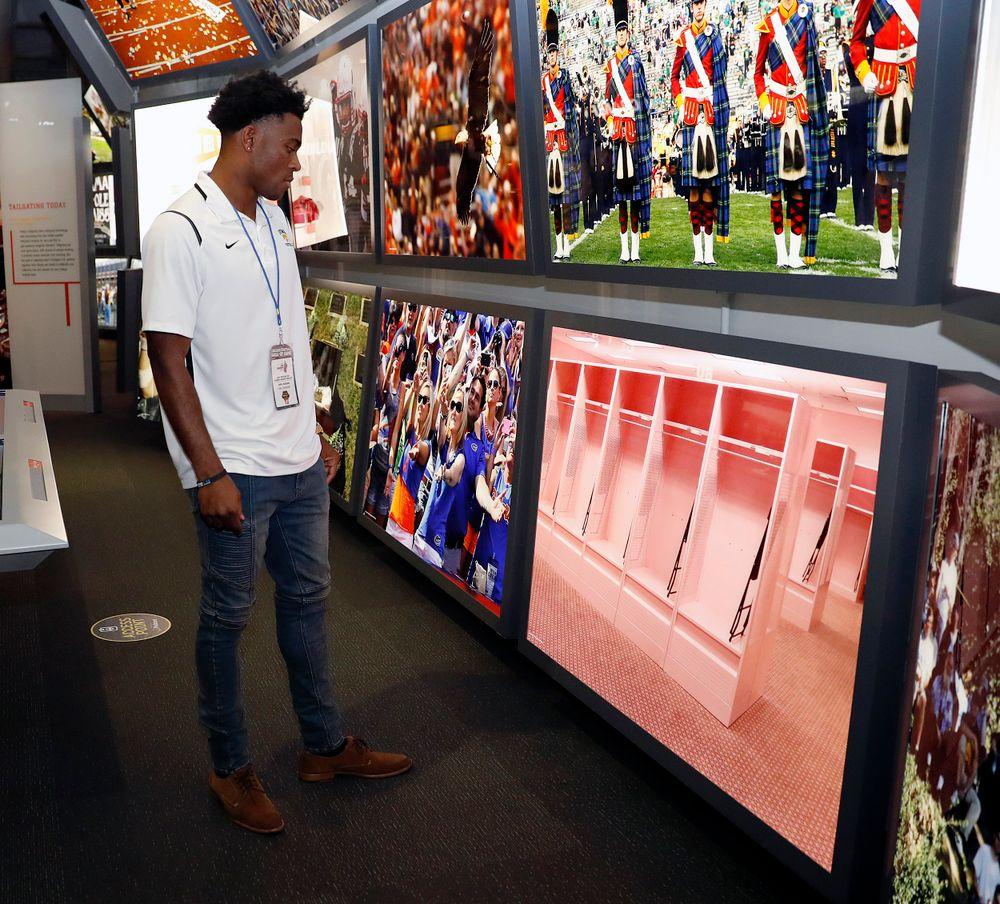Joshua Jackson looks at a photo of Iowa's pink locker room.