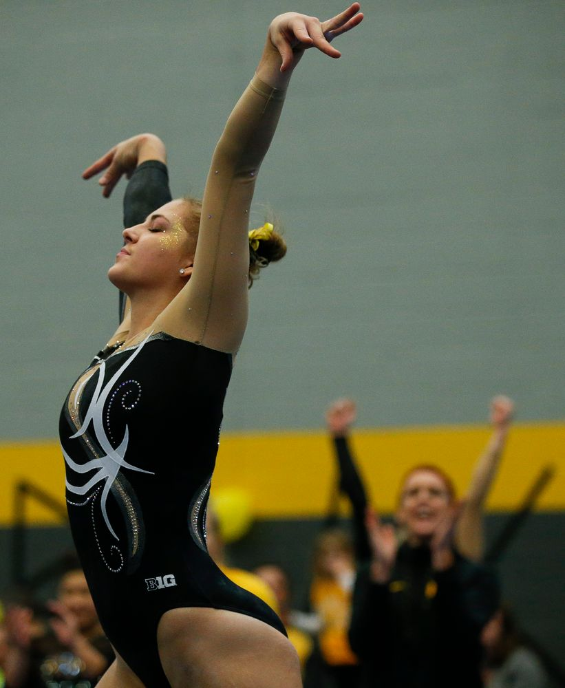 Emma Hartzler competes in the floor exercise during the Black and Gold Intrasquad meet at the Field House on 12/2/17. (Tork Mason/hawkeyesports.com)