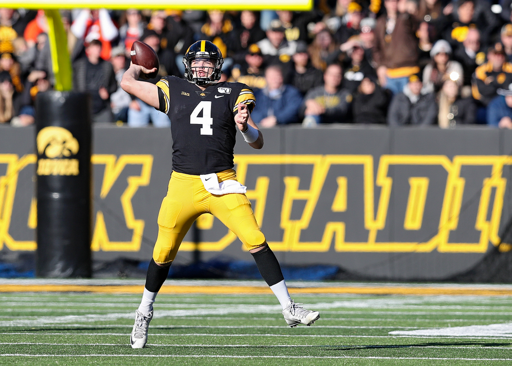 Iowa Hawkeyes quarterback Nate Stanley (4) throws a pass on the run during the third quarter of their game at Kinnick Stadium in Iowa City on Saturday, Nov 23, 2019. (Stephen Mally/hawkeyesports.com)
