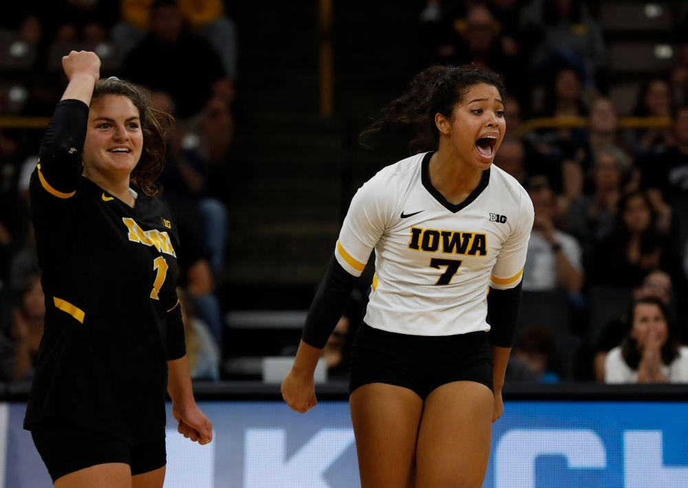 Iowa Hawkeyes setter Gabrielle Orr (7) and defensive specialist Molly Kelly (1) against the Michigan Wolverines Sunday, September 23, 2018 at Carver-Hawkeye Arena. (Brian Ray/hawkeyesports.com)