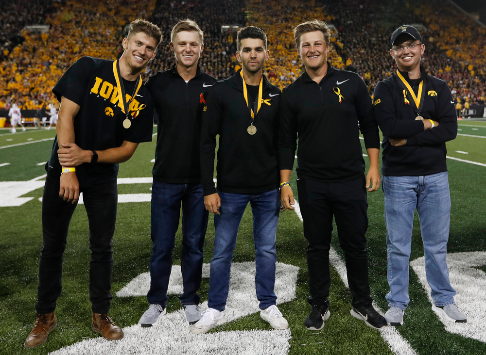 Members of the Iowa men's golf team are recognized by the Presidential Committee on Athletics at halftime during a game against Wisconsin on September 22, 2018. (Tork Mason/hawkeyesports.com)