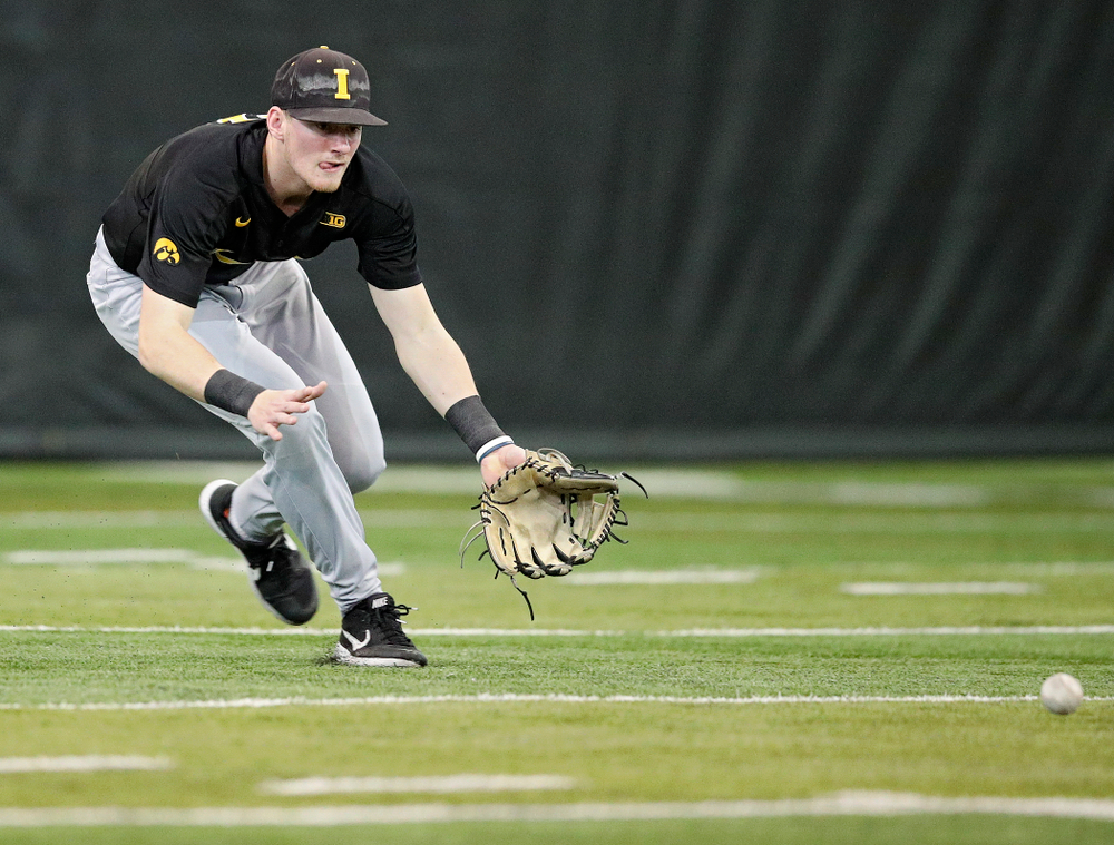 Iowa Hawkeyes infielder Brendan Sher (2) fields a ball during practice at the Hansen Football Performance Center in Iowa City on Friday, January 24, 2020. (Stephen Mally/hawkeyesports.com)