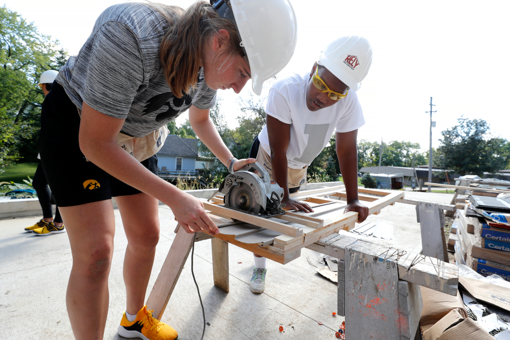 Iowa Hawkeyes guard Kate Martin (20) and guard Zion Sanders (24) work on the Habitat for Humanity Women's Build Wednesday, September 26, 2018 in Iowa City. (Brian Ray/hawkeyesports.com)