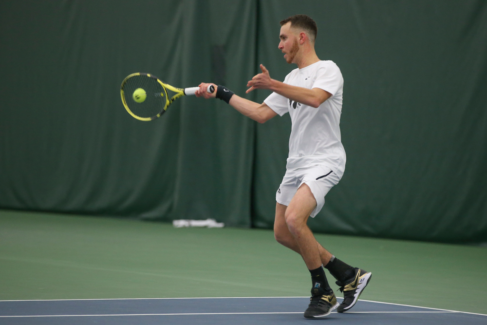 Iowa's Kareem Allaf returns a hit during the Iowa men's tennis meet vs Nebraska on Sunday, March 1, 2020 at the Hawkeye Tennis and Recreation Complex. (Lily Smith/hawkeyesports.com)