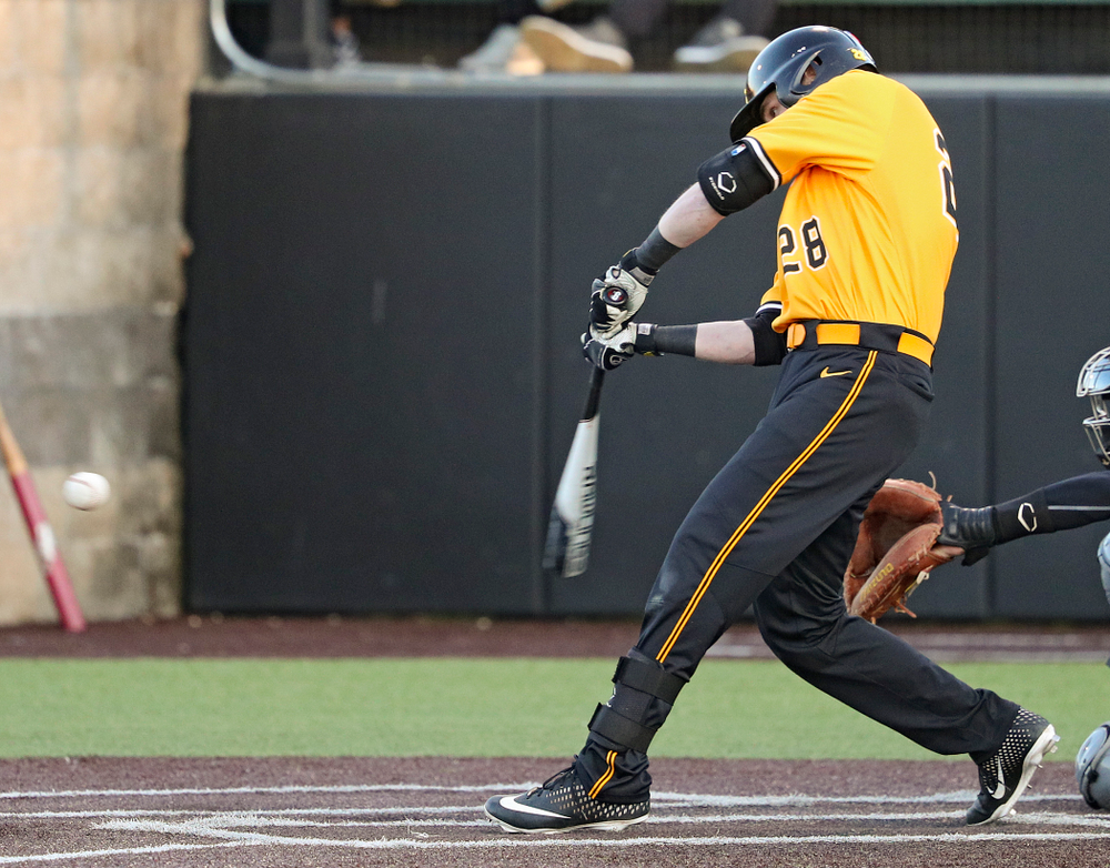 Iowa Hawkeyes left fielder Chris Whelan (28) drives in the winning run with a sacrifice fly during the eighth inning of their game at Duane Banks Field in Iowa City on Tuesday, Apr. 2, 2019. (Stephen Mally/hawkeyesports.com)