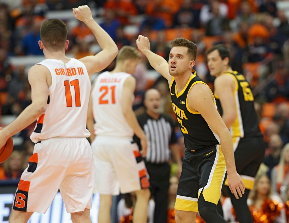 Iowa Hawkeyes guard Jordan Bohannon (3) copies the hand signal of Syracuse Orange guard Joseph Girard III (11) during the first half of their ACC/Big Ten Challenge game at the Carrier Dome in Syracuse, N.Y. on Tuesday, Dec 3, 2019. (Stephen Mally/hawkeyesports.com)