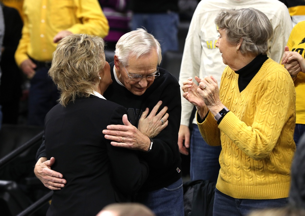 Iowa Hawkeyes head coach Lisa Bluder kisses her father before their game against the Northwestern Wildcats Sunday, March 3, 2019 at Carver-Hawkeye Arena. (Brian Ray/hawkeyesports.com)