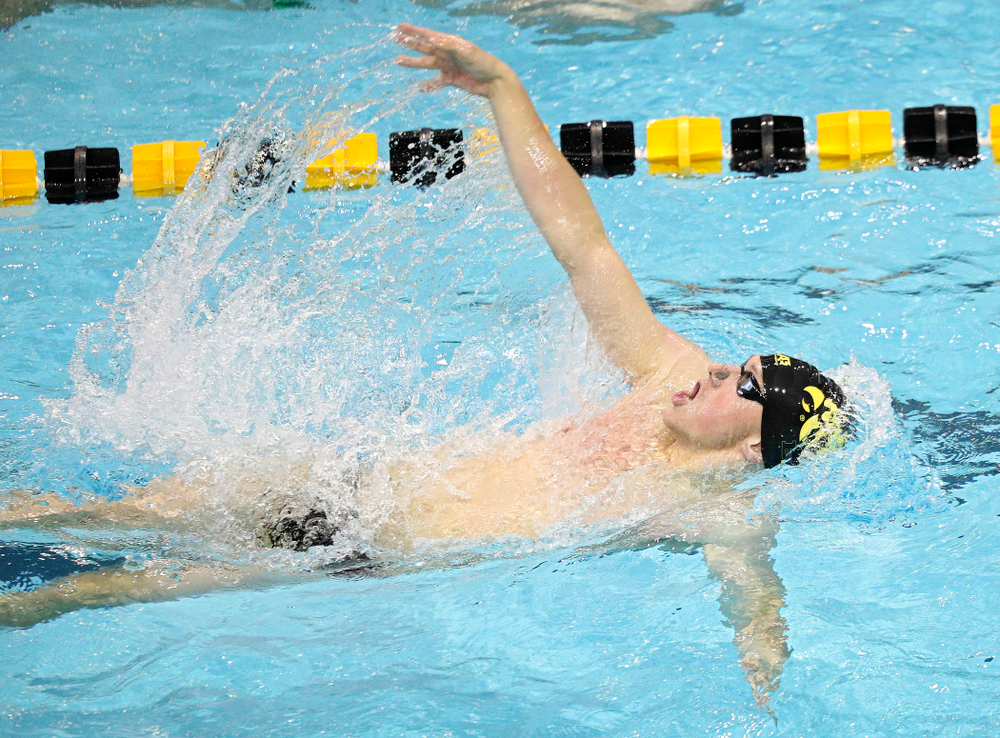Iowa's John Colin swims the men's 100-yard backstroke event during their meet against Michigan State and Northern Iowa at the Campus Recreation and Wellness Center in Iowa City on Friday, Oct 4, 2019. (Stephen Mally/hawkeyesports.com)
