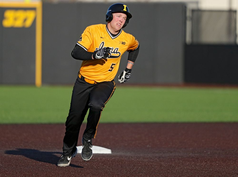 Iowa Hawkeyes pinch hitter Zeb Adreon (5) rounds second base on his way to third after hitting a triple during the seventh inning of their game at Duane Banks Field in Iowa City on Tuesday, Apr. 2, 2019. (Stephen Mally/hawkeyesports.com)