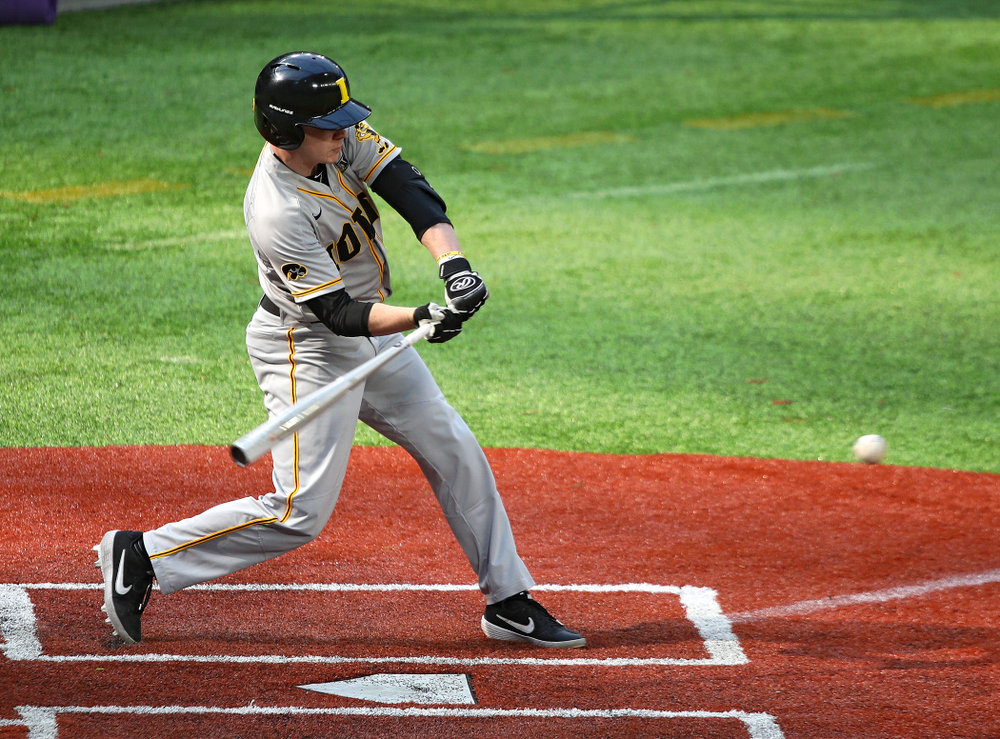 Iowa Hawkeyes utility player Sam Link (3) drives a pitch and reaches on an error during the third inning of their CambriaCollegeClassic game at U.S. Bank Stadium in Minneapolis, Minn. on Friday, February 28, 2020. (Stephen Mally/hawkeyesports.com)