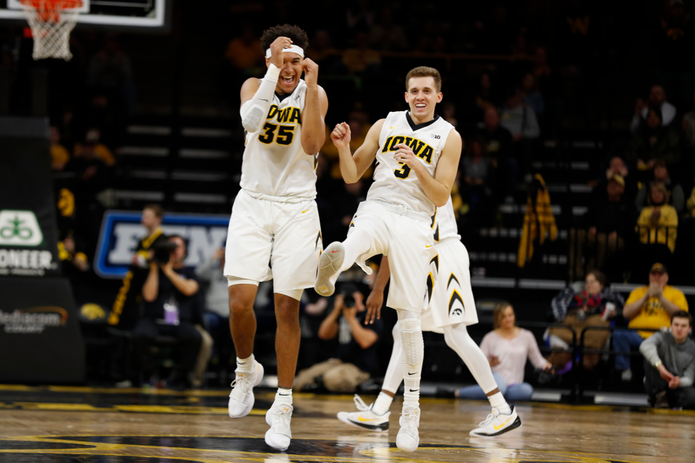 Iowa Hawkeyes forward Cordell Pemsl (35) and guard Jordan Bohannon (3)