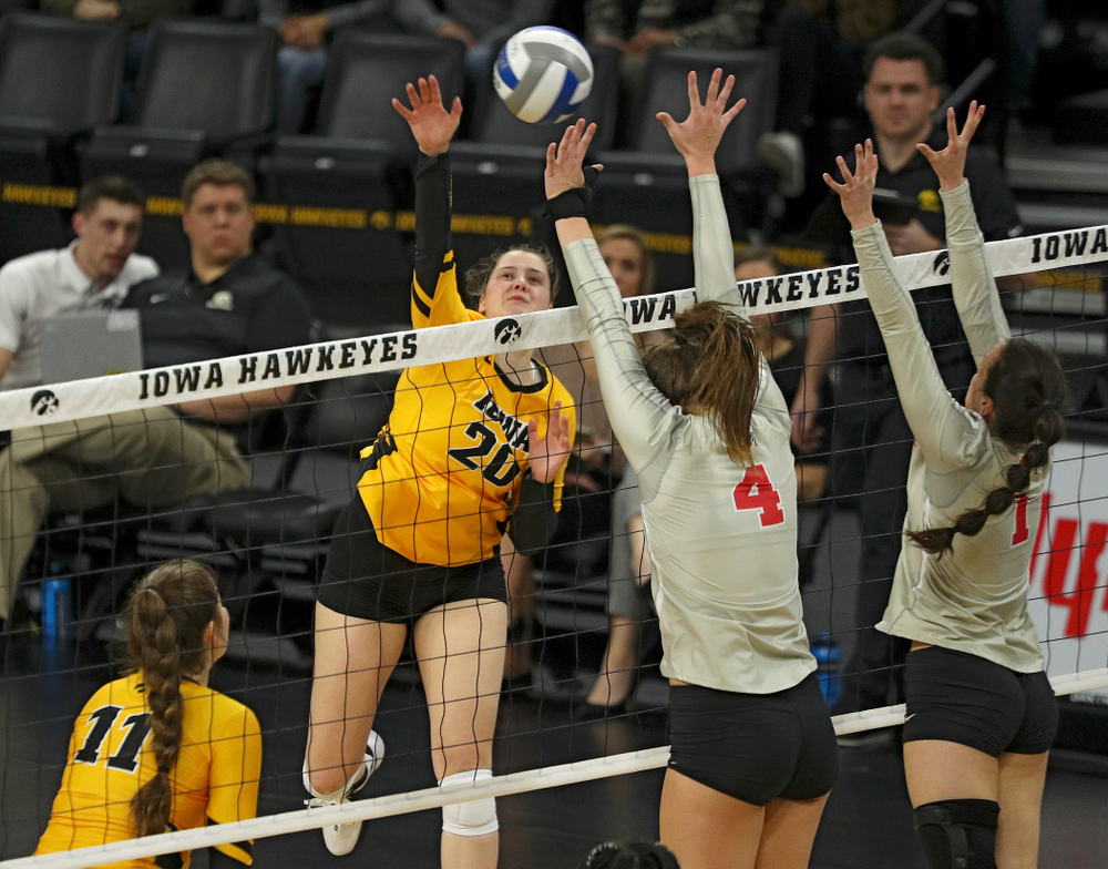 Iowa's Edina Schmidt (20) lines up a kill during the second set of their match at Carver-Hawkeye Arena in Iowa City on Friday, Nov 29, 2019. (Stephen Mally/hawkeyesports.com)
