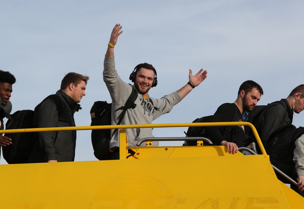 Iowa Hawkeyes punter Colten Rastetter (7) disembarks the team plane Wednesday, December 26, 2018 as they arrive in Tampa, Florida for the Outback Bowl. (Brian Ray/hawkeyesports.com)