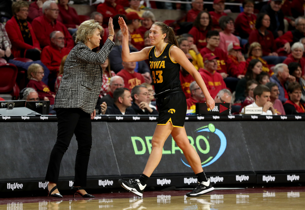 Iowa Hawkeyes forward Amanda Ollinger (43) high fives head coach Lisa Bluder against the Iowa State Cyclones Wednesday, December 11, 2019 at Hilton Coliseum in Ames, Iowa(Brian Ray/hawkeyesports.com)