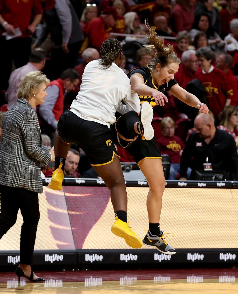 Iowa Hawkeyes guard Kathleen Doyle (22) and guard Zion Sanders (21) against the Iowa State Cyclones Wednesday, December 11, 2019 at Hilton Coliseum in Ames, Iowa(Brian Ray/hawkeyesports.com)