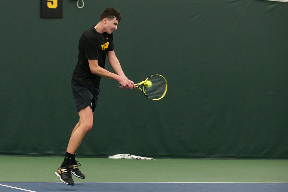 Iowa's Matt Clegg returns a ball during the Iowa men's tennis meet vs VCU  on Saturday, February 29, 2020 at the Hawkeye Tennis and Recreation Complex. (Lily Smith/hawkeyesports.com)
