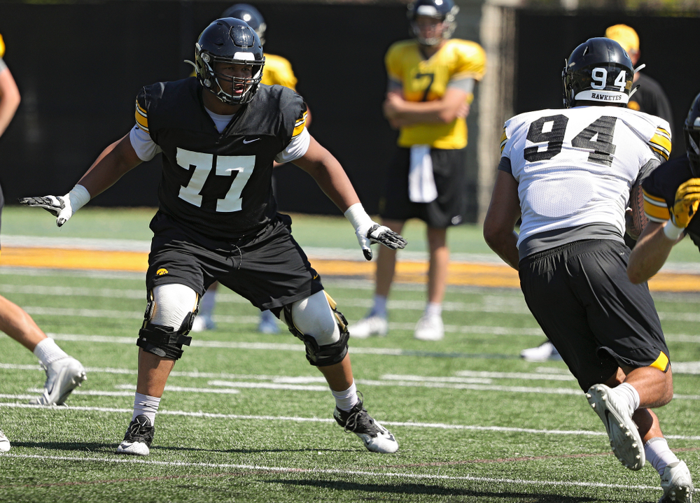 Iowa Hawkeyes offensive lineman Alaric Jackson (77) eyes defensive end A.J. Epenesa (94) during Fall Camp Practice No. 7 at the Hansen Football Performance Center in Iowa City on Friday, Aug 9, 2019. (Stephen Mally/hawkeyesports.com)