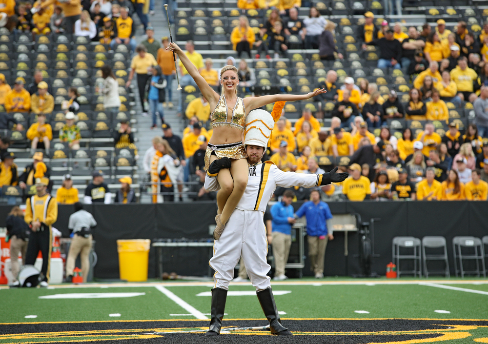 Hawkeye Marching Band Golden Girl Kylene Spanbauer (from left) and Drum Major Michael Janssen on the field with the Hawkeye Marching Band before their game at Kinnick Stadium in Iowa City on Saturday, Sep 28, 2019. (Stephen Mally/hawkeyesports.com)