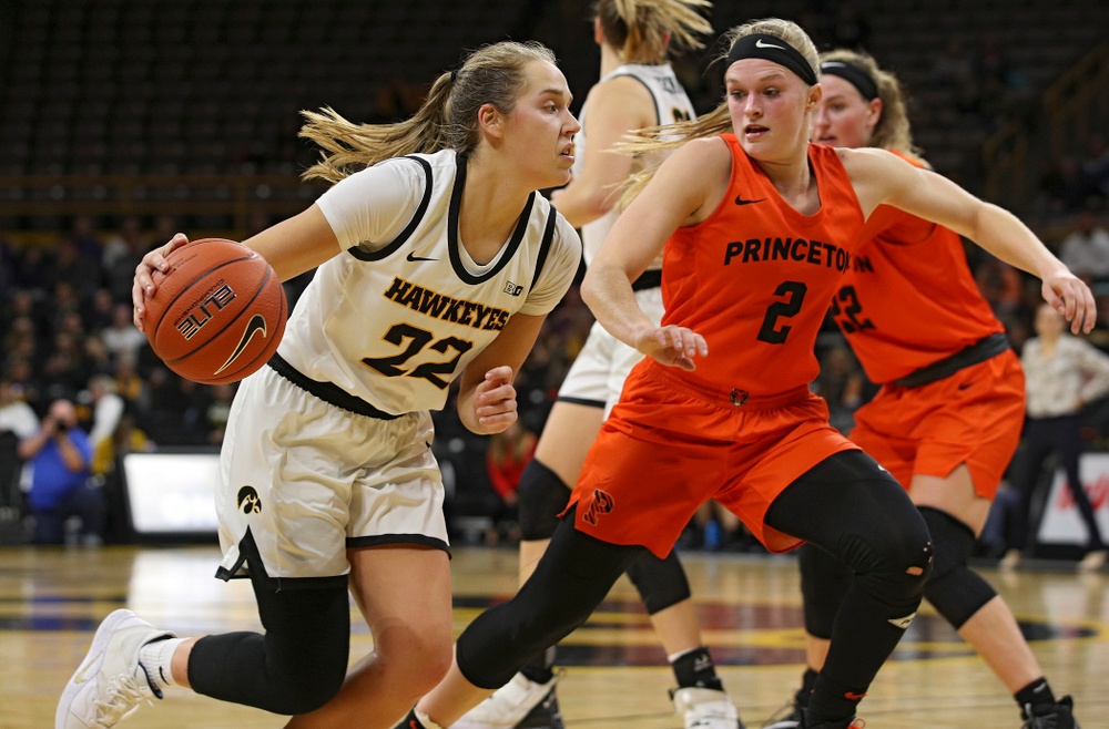 Iowa guard Kathleen Doyle (22) drives with the ball during the fourth quarter of their overtime win against Princeton at Carver-Hawkeye Arena in Iowa City on Wednesday, Nov 20, 2019. (Stephen Mally/hawkeyesports.com)