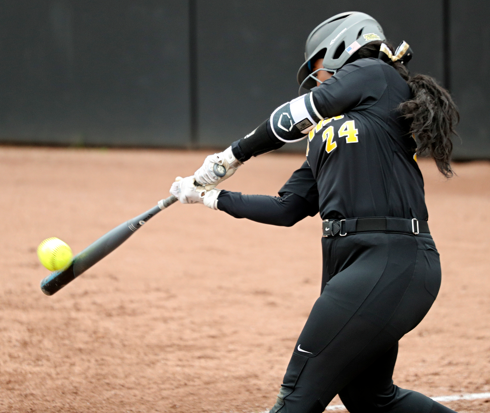 Iowa DoniRae Mayhew (24) hits a 2-run home run during the fourth inning of their game against Iowa Softball vs Indian Hills Community College at Pearl Field in Iowa City on Sunday, Oct 6, 2019. (Stephen Mally/hawkeyesports.com)