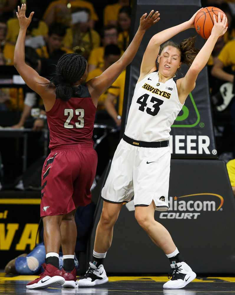 Iowa Hawkeyes forward Amanda Ollinger (43) pulls down a rebound during a game against North Carolina Central at Carver-Hawkeye Arena on November 17, 2018. (Tork Mason/hawkeyesports.com)