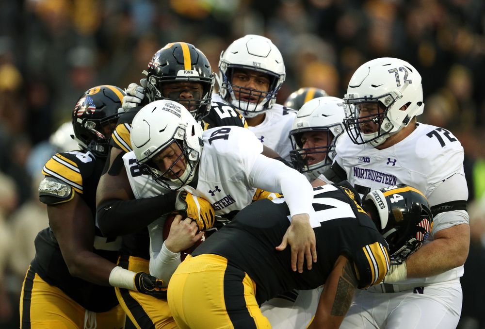 Iowa Hawkeyes defensive end Chauncey Golston (57) and defensive end A.J. Epenesa (94) against the Northwestern Wildcats Saturday, November 10, 2018 at Kinnick Stadium. (Brian Ray/hawkeyesports.com)