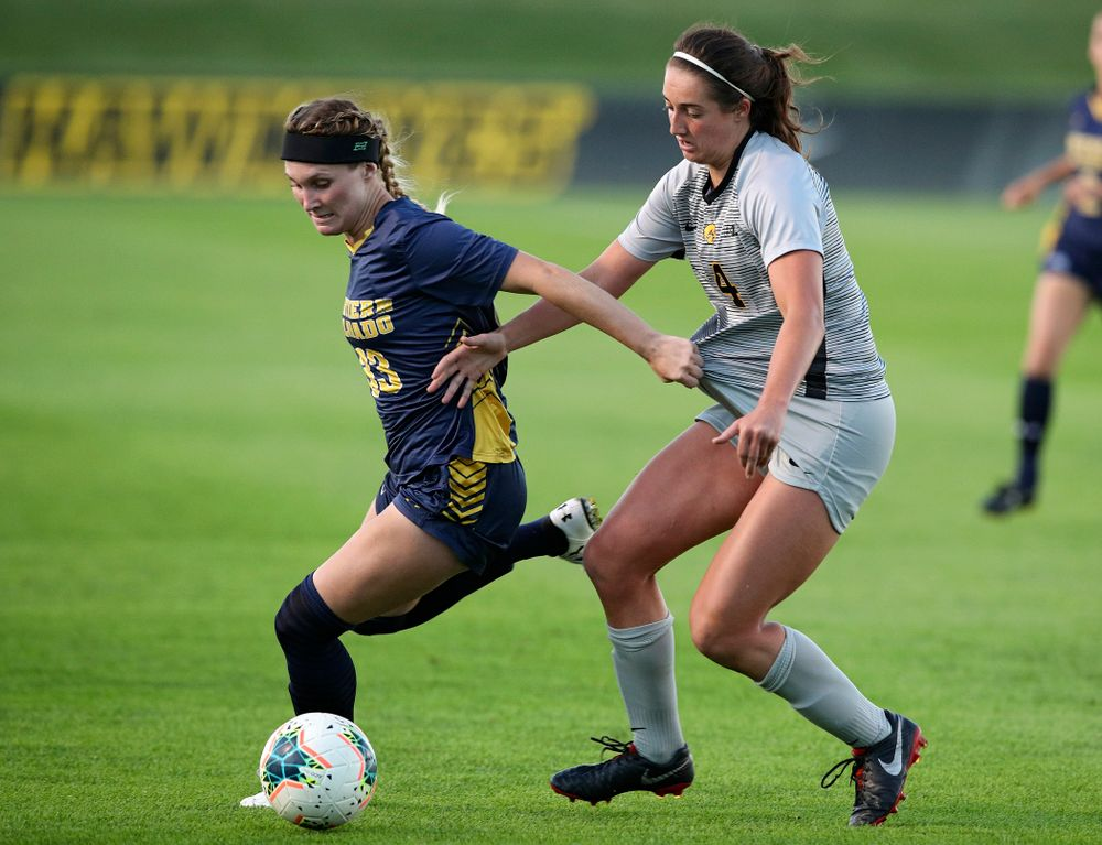 Iowa forward Kaleigh Haus (4) battles for position on the ball during the first half of their match at the Iowa Soccer Complex in Iowa City on Friday, Sep 13, 2019. (Stephen Mally/hawkeyesports.com)