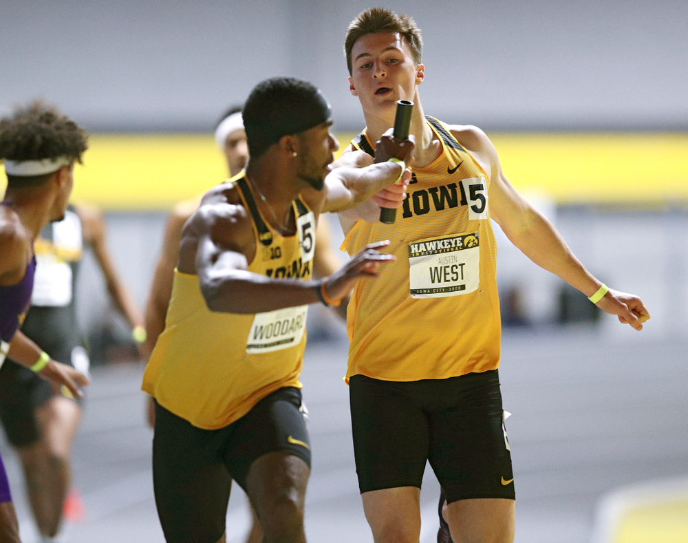 Iowa's Austin West (right) hands off the baton to Antonio Woodard as they run the men's 1600 meter relay event during the Hawkeye Invitational at the Recreation Building in Iowa City on Saturday, January 11, 2020. (Stephen Mally/hawkeyesports.com)