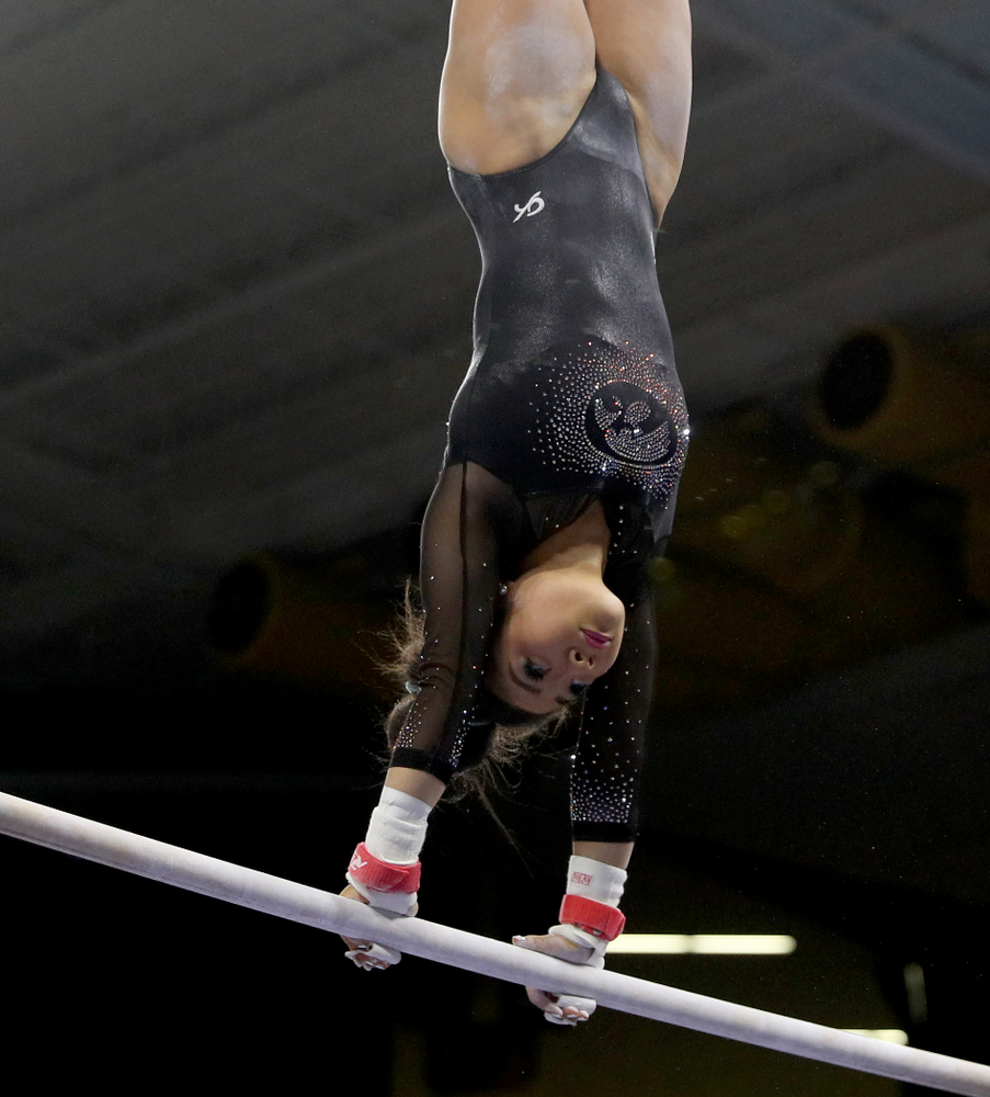 Iowa's Clair Kaji competes on the bars against Michigan Friday, February 14, 2020 at Carver-Hawkeye Arena. (Brian Ray/hawkeyesports.com)
